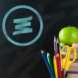 Back to school theme using school supplies and blackboard